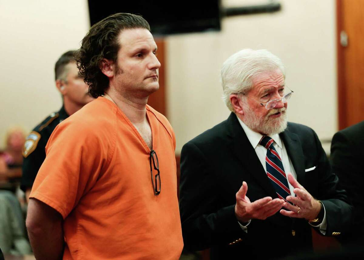 Leon Jacob, center, appears with his attorney, George Parnham, before felony judge Jim Wallace to request bond on Wednesday, July 12, 2017, in Houston. Jacob is being held without bail, accused in a murder-for-hire plot involving his girlfriend, a prominent Montrose veterinarian, in an alleged scheme to kill their exes. ( Brett Coomer / Houston Chronicle )