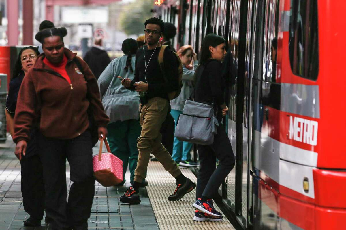 People get on and off a Metropolitan Transit Authority train along Fannin Street at Dryden Road on Feb. 14, 2018 in the Texas Medical Center. To give people more space, Metro has added shuttles in the medical center during the COVID-19 response.