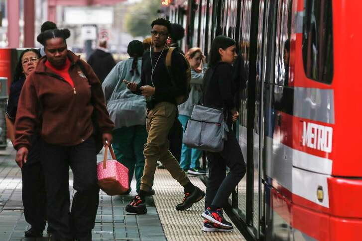 People get off a Metropolitan Transit Authority train in the Texas Medical Center at Fannin Street and Dryden Road on Feb. 14, 2018 in Houston.