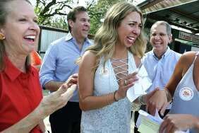 Lauren Kraut, center, celebrates with her mother Nancy Kraut, from left, her father Bob Kraut, and other family members, after she found her match to be in Dallas, during the National Match Day for UT Health San Antonio students, at John T. Floore Country Store on Friday, March 16, 2018. Kraut will be going to University of Texas Southwestern Medical Center.