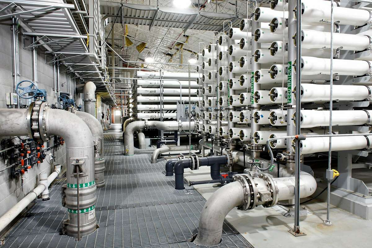 Reverse osmosis pressure vessel tubes use semi-permeable membranes to filter salt from water being processed at the Alameda County Water District's Newark Desalination Facility in Newark.