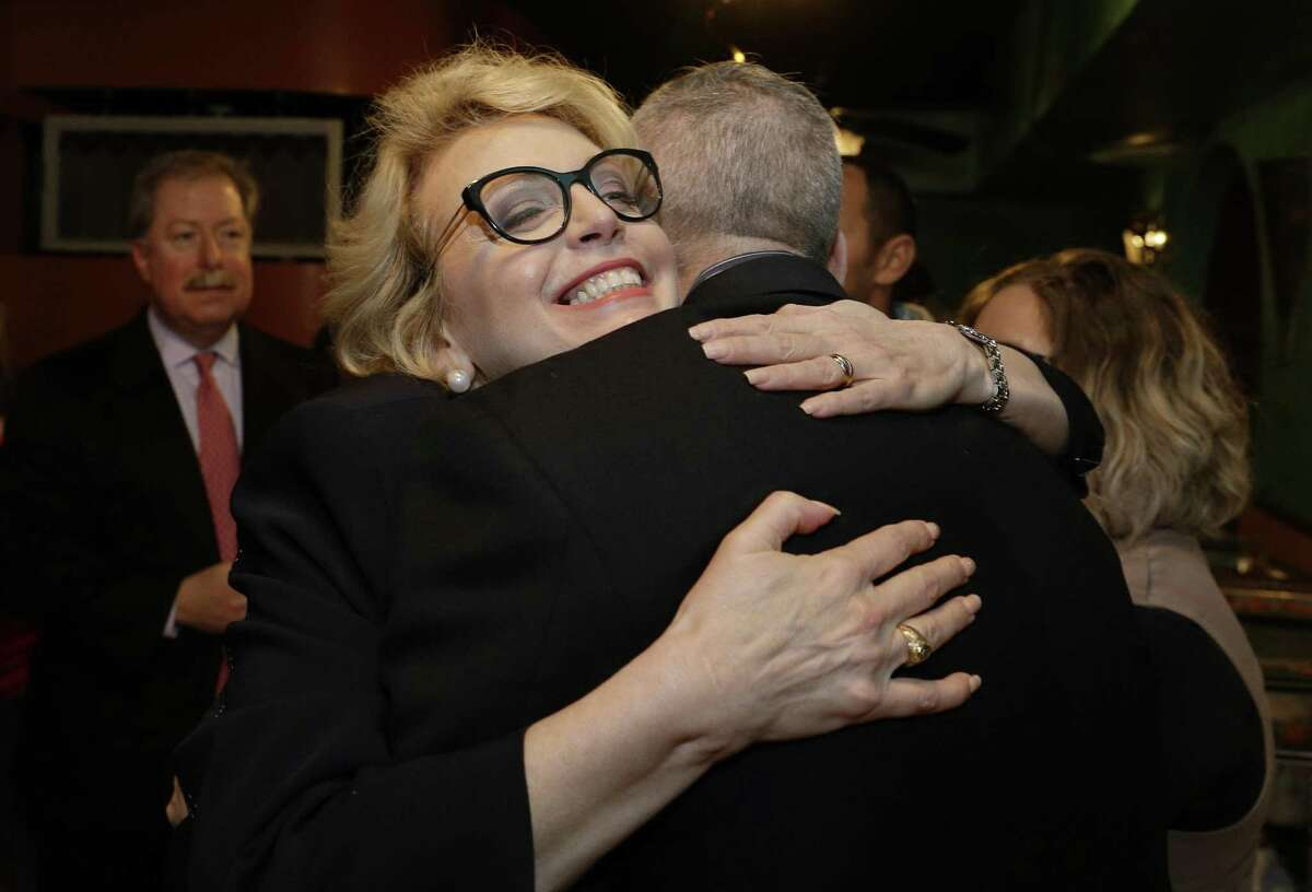 Kathaleen Wall, Republican candidate to replace Ted Poe in Congress, hugs supporters at her watch party at the Adobe Cafe in Houston on Tuesday, March 6, 2018. (Michael Wyke/Houston Chronicle via AP)