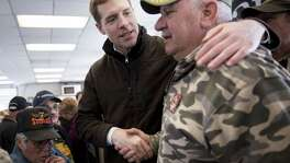 Conor Lamb, Democratic candidate for the U.S. House of Representatives, center, greets an attendee after speaking during a campaign rally with members of the United Mine Workers of America (UMWA) at the Greene County Fairgrounds in Waynesburg, Pennsylvania, U.S., on Sunday, March 11, 2018. Lamb is locked into a tight race with Republican state representative Rick Saccone ahead of a March 13 special election for a U.S. House seat in southwest Pennsylvanias 18th congressional district seat that was vacated by Republican Tim Murphy following a sexual harassment scandal. Photographer: Andrew Harrer/Bloomberg