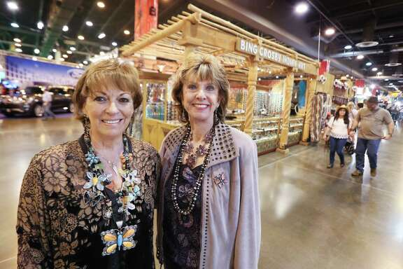 Bing Crosby Indian Art general manager Carol Yeager Berger, left, and owner Vickie Crosby share a moment together at their last Houston rodeo.