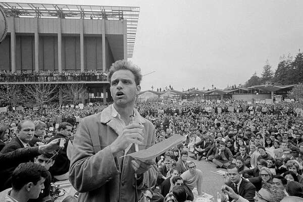 FILE - In this Dec. 7, 1964 file photo, Mario Savio, leader of the Berkeley Free Speech Movement, speaks to assembled students on the campus at the University of California in Berkeley, Calif. The fall of 2014 marks the 50th anniversary of the Free Speech Movement, a protest that only lasted for three months but set the stage for the turbulent 1960s. (AP Photo/Robert W. Klein, File)