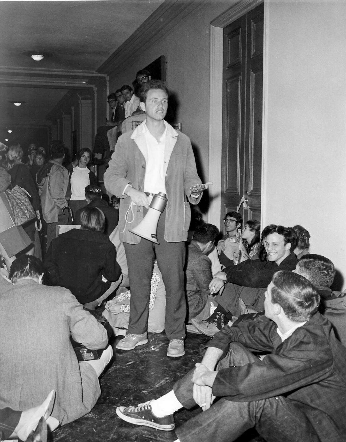 File - (AP) In the Beginning. In 1964, the freshman class to the University of California, Berkeley, found themselves involved with the Free Speech Movement, a protest against the campus administration and policies. Led by Mario Savio, with bullhorn, some 700 demonstrators held a sit-in at Sproul Hall in open defiance of administration orders. (AP-Photo) 24.5.1968