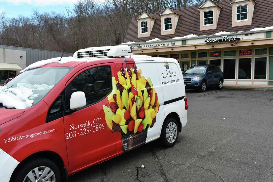 An Edible Arrangements delivery van and storefront at 456 Main Ave. in Norwalk, Conn., in mid-February 2018. Photo: Alexander Soule / Hearst Connecticut Media / Stamford Advocate