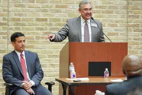 Incumbent district attorney Nico LaHood, left, and DA candidate Joe Gonzales participate in a debate, Thursday, Feb. 8, 2018, at the Claude Black Community Center in San Antonio. (Darren Abate/For the San Antonio Express-News)