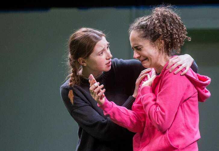 Actors Emma Roos, left, and Carolyn Faye Kramer perform a scene during a rehearsal for the play, The Wolves, at Marin Theater Company Friday, March 9, 2018 in Mill Valley, Calif.