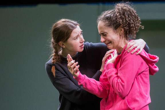 Actors Isabel Langen, left, and Carolyn Faye Kramer perform a scene during a rehearsal for the play, The Wolves, at Marin Theater Company Friday, March 9, 2018 in Mill Valley, Calif.