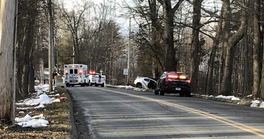 Wallingford police investigate Friday afternoon's Highland Avenue crash that seriously injured two Sheehan High School students Photo: Brian Zahn / Hearst Connecticut Media
