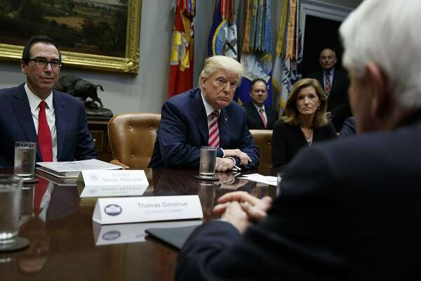 "FILE- In this Oct. 31, 2017, file photo, Tom Donohue, President and CEO, U.S. Chamber of Commerce, foreground, speaks as Treasury Secretary Steve Mnuchin, left, President Donald Trump, second from left, and Karen Kerrigan, President and CEO, Small Business & Entrepreneurship Council, listen during a meeting in Washington. The U.S. Chamber of Commerce is warning Trump against slapping big tariffs on Chinese imports. ""Simply put, tariffs are damaging taxes on American consumers,'' Donohue said in a statement. (AP Photo/Evan Vucci, File)"