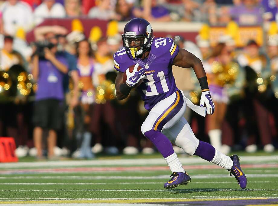 MINNEAPOLIS, MN - SEPTEMBER 28:  Jerick McKinnon #31 of the Minnesota Vikings advances the ball against the Atlanta Falcons on September 28, 2014 at TCF Bank Stadium in Minneapolis, Minnesota. (Photo by Adam Bettcher/Getty Images) Photo: Adam Bettcher, Getty Images