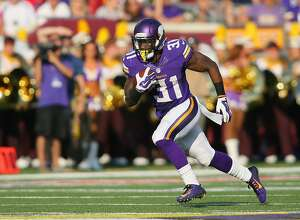 MINNEAPOLIS, MN - SEPTEMBER 28:  Jerick McKinnon #31 of the Minnesota Vikings advances the ball against the Atlanta Falcons on September 28, 2014 at TCF Bank Stadium in Minneapolis, Minnesota. (Photo by Adam Bettcher/Getty Images)