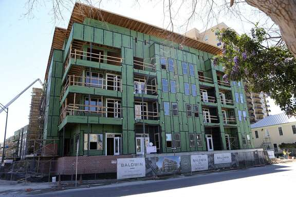 A city nonprofit is partnering with developer NRP Group to build the Baldwin at St. Paul Square apartments on the near East Side.