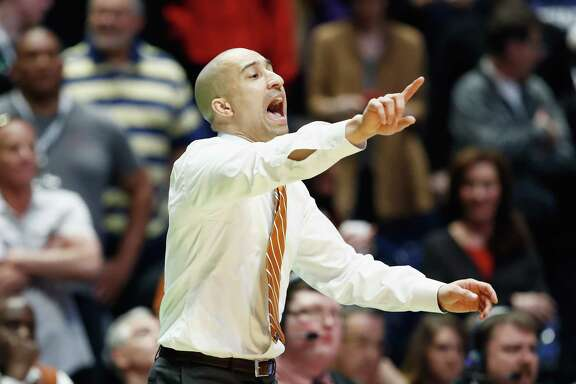 NASHVILLE, TN - MARCH 16:  Head coach Shaka Smart of the Texas Longhorns reacts against the Nevada Wolf Pack during the game in the first round of the 2018 NCAA Men's Basketball Tournament at Bridgestone Arena on March 16, 2018 in Nashville, Tennessee.