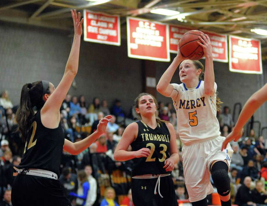 Isabella Santoro (5) and the Mercy girls basketball team will face Hall on Saturday in the Class LL championship game. Photo: Christian Abraham / Hearst Connecticut Media / Connecticut Post