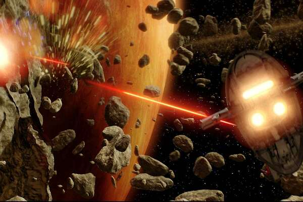 "Jango Fett's Slave I fires its laser cannons at Obi-Wan Kenobi's Jedi starfighter in a scene from the new film ""Star Wars Episode II Attack of the Clones"" directed by George Lucas which opens on May 16, 2002.   REUTERS/DIGITAL WORK BY ILM/Lucasfilm Ltd./Handout     NO SALES  ALSO RAN 05/24/02"