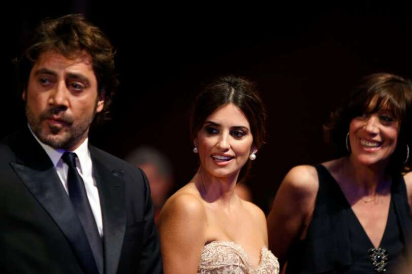 From left, Actor Javier Bardem, actress Penelope Cruz and Monica Bardem arrive during the awards cer