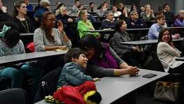 Jonah Nirenberg, 9, leans into his mother, Erika Prosper as their father and husband respectively, Ron Nirenberg, mentions them Monday, March 12, 2018 in Philadelphia, Pa. The San Antonio Mayor presented the 2018 George Gerbner Lecture in Communication ÒBe a Better Neighbor: The Education of a Mayor,Ó at the Annenberg School for Communication at the University of Pennsylvania. (Corey Perrine/For the San Antonio Express-News)