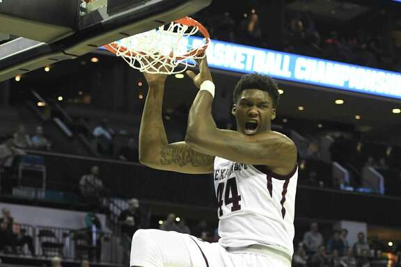 Texas A&M's Robert Williams (44) reacts after a dunk against Providence during the first round of the NCAA Tournament at the Spectrum Center in Charlotte, N.C., on Friday, March 16, 2018. Texas A&M advanced, 73-69. (David T. Foster III/Charlotte Observer/TNS)