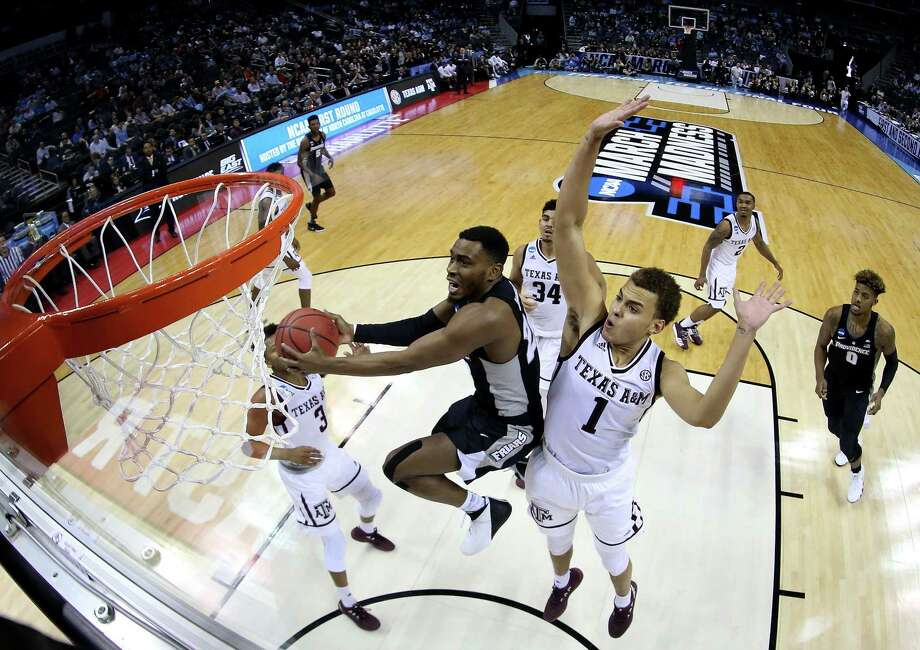 CHARLOTTE, NC - MARCH 16:  Kyron Cartwright #24 of the Providence Friars shoots against the Texas A&M Aggies during the first round of the 2018 NCAA Men's Basketball Tournament at Spectrum Center on March 16, 2018 in Charlotte, North Carolina.  (Photo by Streeter Lecka/Getty Images) Photo: Streeter Lecka, Staff / Getty Images / 2018 Getty Images