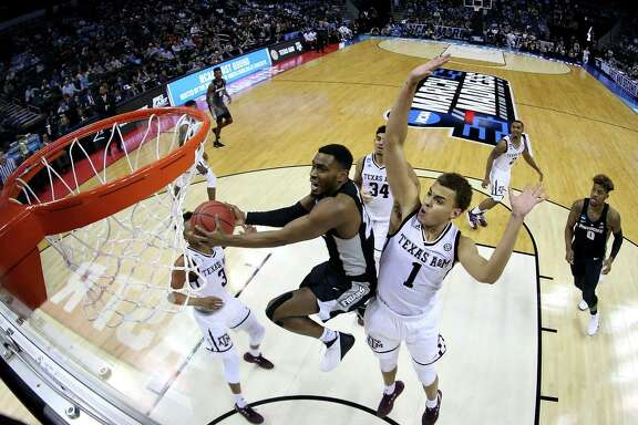CHARLOTTE, NC - MARCH 16:  Kyron Cartwright #24 of the Providence Friars shoots against the Texas A&M Aggies during the first round of the 2018 NCAA Men's Basketball Tournament at Spectrum Center on March 16, 2018 in Charlotte, North Carolina.  (Photo by Streeter Lecka/Getty Images)