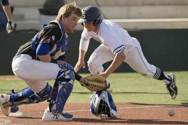 Midland Christian's Zac Tiltin looks to get the ball but can not hold on as Ft. Worth All Saints' A.J. Mendolia scores on a sacrifice bunt 03/16/18 at Christensen Stadium. Tim Fischer/Reporter-Telegram