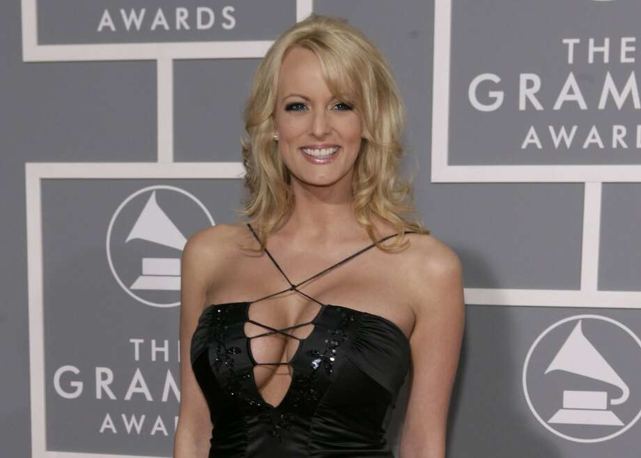 FILE - In this Feb. 11, 2007, file photo, adult film actress Stormy Daniels arrives for the 49th Annual Grammy Awards in Los Angeles. New documents show a top lawyer for the Trump Organization was involved in legal efforts to keep adult film star Daniels from talking about her alleged affair with President Donald Trump. The arbitration documents are signed by Trump Organization lawyer Jill A. Martin and list her address as that of Trump's golf club in Los Angeles. (AP Photo/Matt Sayles, File) Photo: Matt Sayles, Associated Press