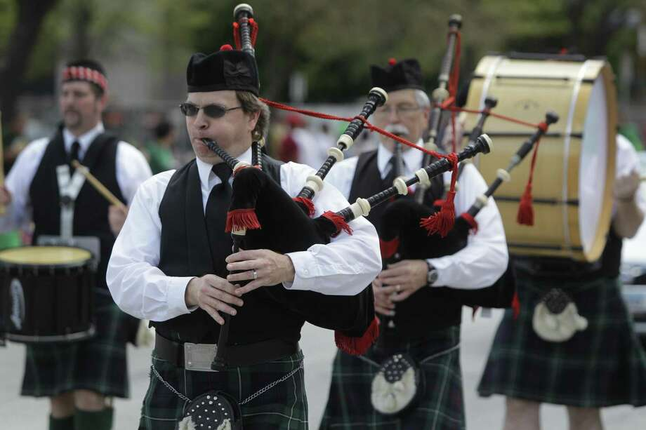 Bagpipers and drummers perform during the 54th annual Houston St. Patrick's Day Parade in 2013. Photo: Melissa Phillip, Staff / Houston Chronicle / © 2013  Houston Chronicle