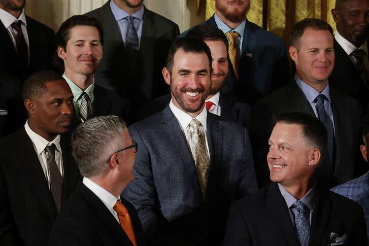 Houston Astros pitcher Justin Verlander (C) joins his teammates for a celebration of their World Series victory in the East Room of the White House. (Photo by Chip Somodevilla/Getty Images)