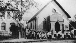 Students in 1903 walk in a procession into St. Peter Claver Church, a church built in 1888 by Margaret Mary Healy Murphy to serve the African-American community on the city's East Side.