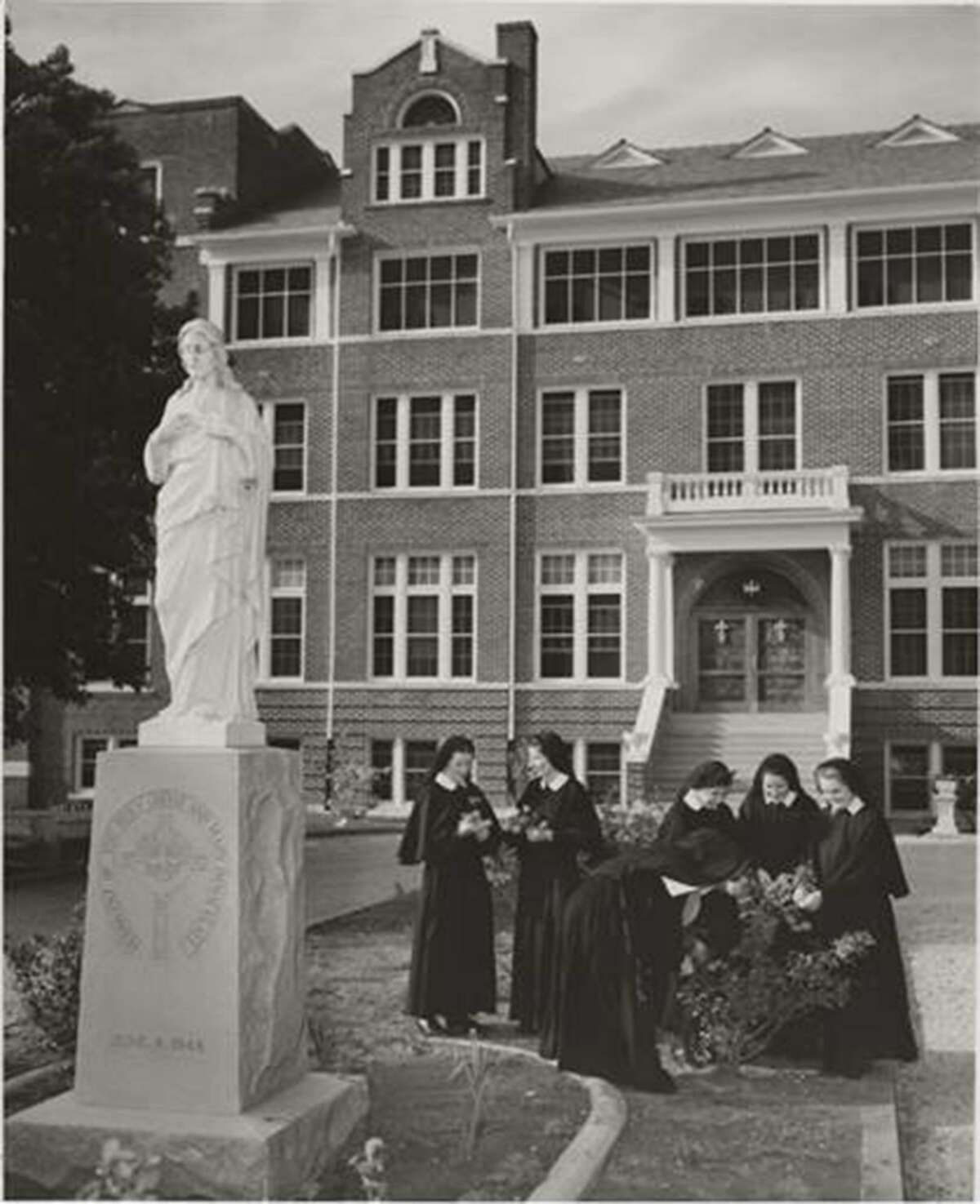 Postulants gather in front of the 1922 mother house of the Sisters of the Holy Spirit and Mary Immaculate on Yucca Street on the city's East Side.