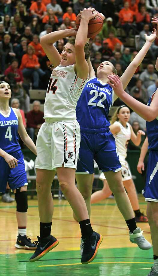 Cambridge's Fiona Mooney battles for a rebound with Millbrook's Carrie Halpin during the Class C state semifinal at Hudson Valley Community College on Friday, March 16, 2018 in Troy, N.Y. (Lori Van Buren/Times Union) Photo: Lori Van Buren / 20043216A