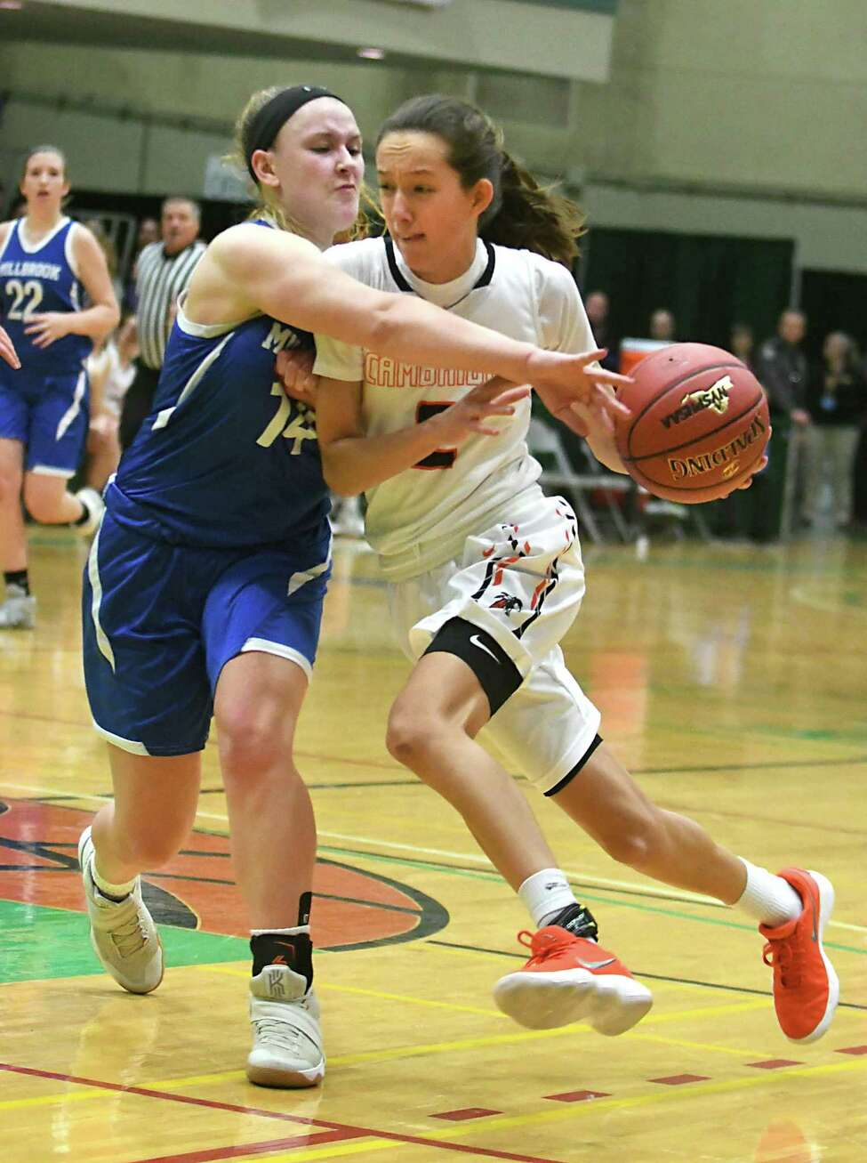 Cambridge's Sophie Phillips drives to the basket guarded by Millbrook's Brooke Babbitt during the Class C state semifinal at Hudson Valley Community College on Friday, March 16, 2018 in Troy, N.Y. (Lori Van Buren/Times Union)