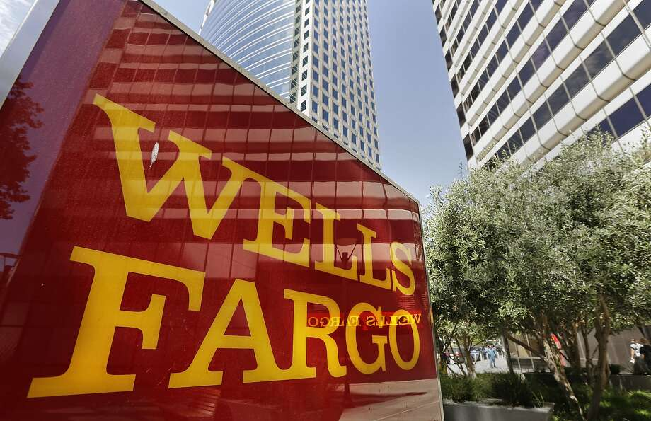 FILE - This July 14, 2014 file photo shows Wells Fargo offices in Oakland. Organizers say Wells Fargo and Chase are leading financiers of two large for-profit prison corporations, CoreCivic and GEO Group, which operated immigration detention centers.  Photo: Ben Margot, Associated Press