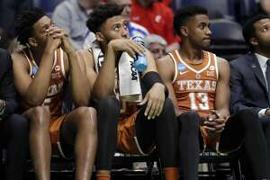 Texas guard Jase Febres (13) and teammates watch from the bench in overtime of a first-round game against Nevada in the NCAA college basketball tournament in Nashville, Tenn., Friday, March 16, 2018. Nevada won 87-83. (AP Photo/Mark Humphrey)