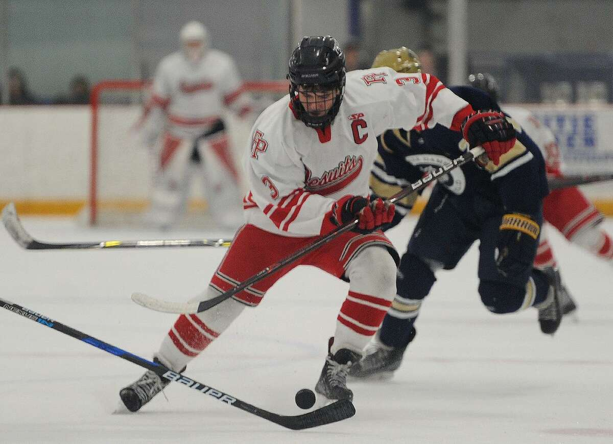 Fairfield Prep's Skyler Celotto skates the puck in to the offensive zone in the second period against Notre Dame-Fairfield in the Division I quarterfinals on March 11.