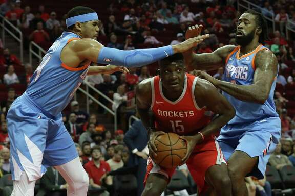 The Rockets' Clint Capela, center, blanketed by the Clippers' Tobias Harris, left, and DeAndre Jordan during Thursday's game, must deal with a red-hot Anthony Davis and the Pelicans in New Orleans.