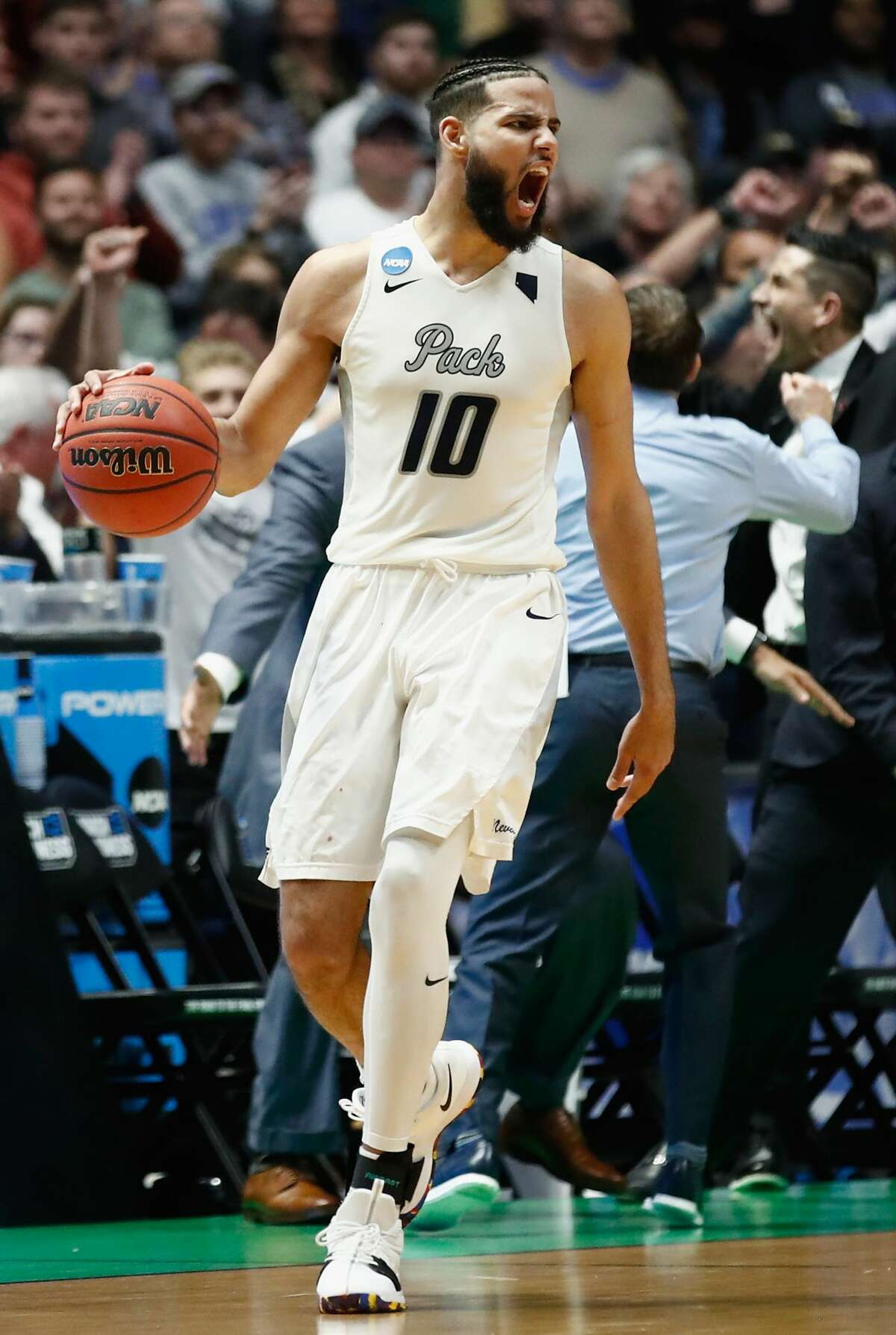 NASHVILLE, TN - MARCH 16: Caleb Martin #10 of the Nevada Wolf Pack celebrates as they defeat the Texas Longhorns during the game in the first round of the 2018 NCAA Men's Basketball Tournament at Bridgestone Arena on March 16, 2018 in Nashville, Tennessee. (Photo by Andy Lyons/Getty Images)