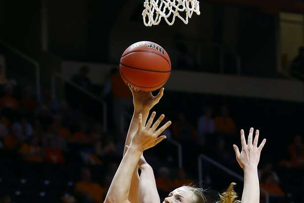 Oregon State center Marie Gulich shoots as she's defended by Western Kentucky forward Ivy Brown (23) in the first half of a first-round game in the NCAA college basketball tournament Friday, March 16, 2018, in Knoxville, Tenn. (AP Photo/Wade Payne)