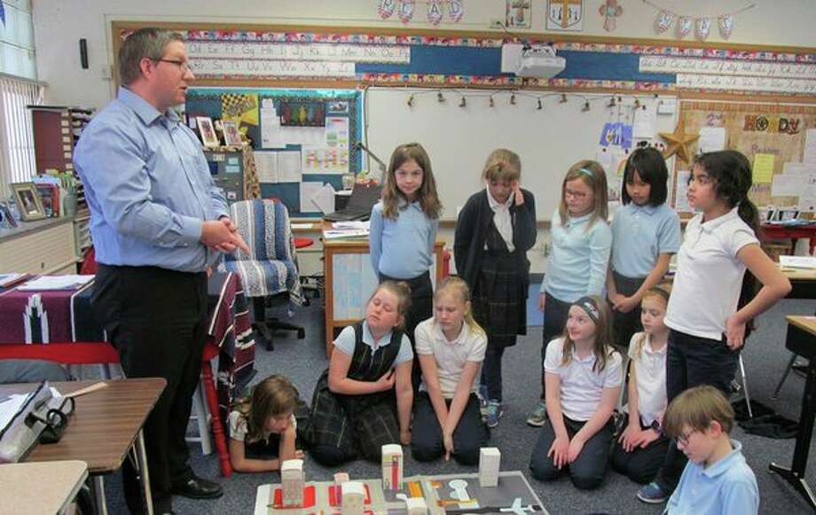 Students at Blessed Sacrament learn about the job of a city planner during a recent Junior Achievement class. Students designed buildings to place in the business, agricultural, industrial, residential and multipurpose zones. (Photo provided)