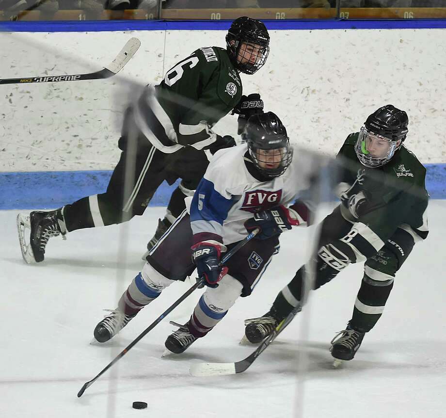 Farmington Valley leads, 2-0, over Guilford in the CIAC Division II state Ice Hockey Championship, March 16, 2018, at Ingalls Rink in New Haven. Photo: Catherine Avalone, Hearst Connecticut Media / New Haven Register