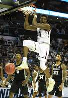 """Texas A&M's Robert Williams reacts after his """"nasty"""" dunk against Providence during an NCAA Tournament first-round game at the Spectrum Center in Charlotte, N.C., on Friday."""
