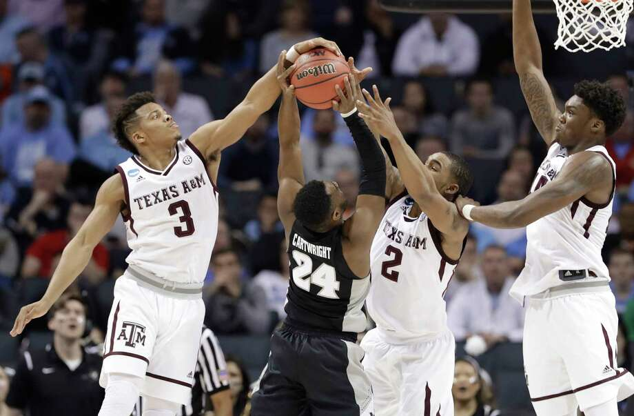 PHOTOS: Best Texas colleges for every degree  Providence's Kyron Cartwright (24) has his shot blocked by Texas A&M's Admon Gilder (3) and T.J. Starks (2) during the second half at Charlotte on Friday.  >>>Browse through the photos for a look at the best Texas colleges for every degree ...  Photo: Gerry Broome, STF / Copyright 2018 The Associated Press. All rights reserved.