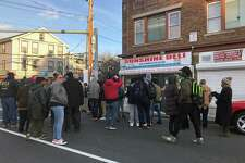 Around 100 community members and leaders marched from Baker-Isaac's Funeral Services at 985 Stratford Ave., in Bridgeport, Conn., to the Sunshine Deli at 1306 Stratford Ave. to ask the owner to close his doors earlier in an attempt to deter some of the violence in the area.