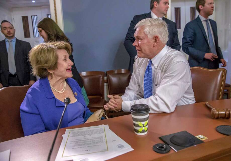 In this Dec. 20, 2017, photo, Rep. Louise Slaughter, D-N.Y., the top Democrat on the House Rules Committee, left, meets with Chairman Pete Sessions, R-Texas, right, to approve some procedural corrections in the final version of the Republican tax bill, on Capitol Hill, in Washington. Slaughter died Friday days after falling in her residence, her top aide said. The 88-year-old lawmaker had been the first woman to chair the House Rules Committee. (AP Photo/J. Scott Applewhite) Photo: J. Scott Applewhite / Copyright 2018 The Associated Press. All rights reserved.