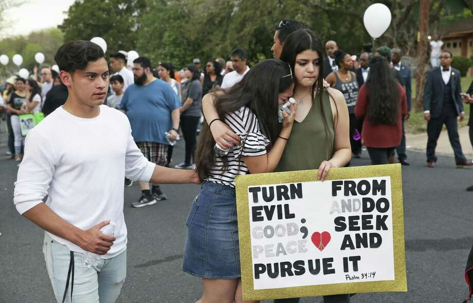 Participants grieve while walking away from the crime scene as Eastside community members hold a peace march on March 16, 2018, through neighborhood streets leading to the home on Oldfort Hill in Austin where 17-year-old Draylen Mason was killed by a package bomb earlier this week. Photo: Tom Reel /San Antonio Express-News / 2017 SAN ANTONIO EXPRESS-NEWS