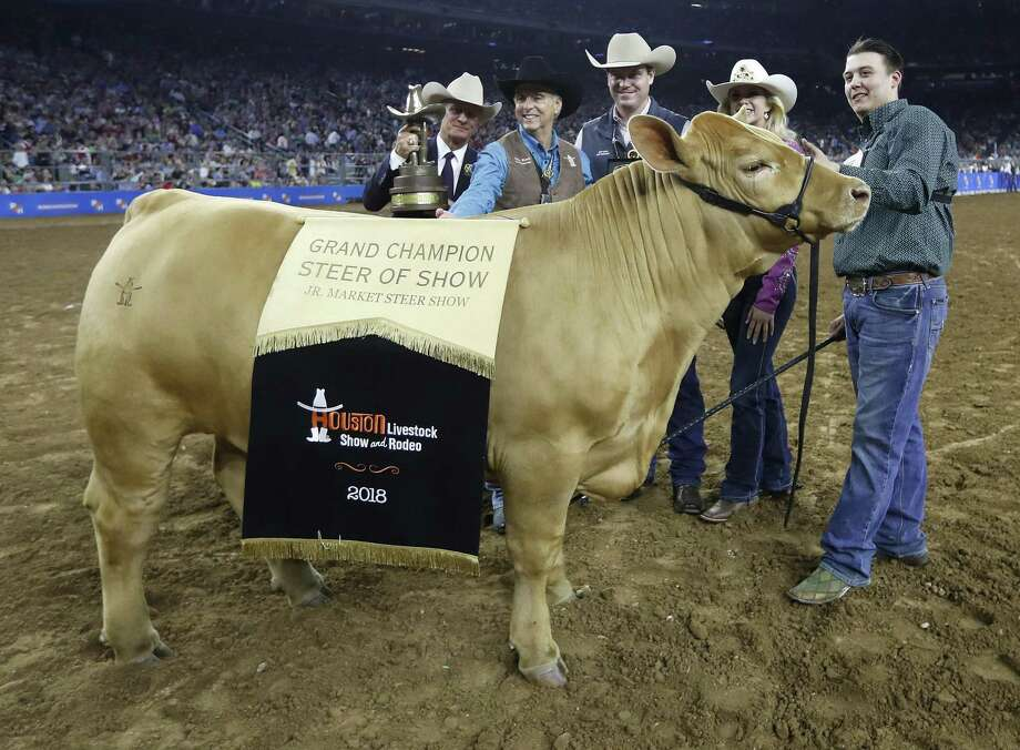 Cameron Conkle, of Allen, raised the with the Allen FFA with his Grand Champion Charolais during the Houston Livestock Show and Rodeo at NRG Stadium, Friday, March 16, 2018, in Houston.>>Who we spotted in the crowd at Rodeo this year  Photo: Karen Warren / Karen Warren / Houston Chronicle / © 2018 Houston Chronicle
