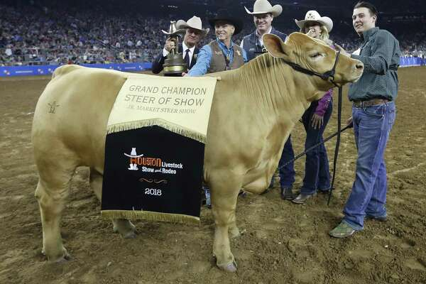 Cameron Conkle, of Allen, raised the with the Allen FFA with his Grand Champion Charolais during the Houston Livestock Show and Rodeo at NRG Stadium, Friday, March 16, 2018, in Houston.